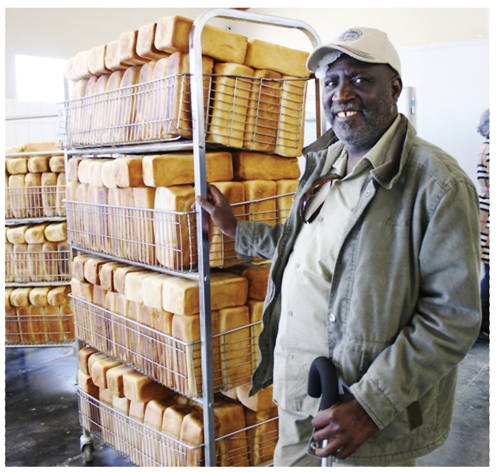 Joseph Naidyala at the new and bigger Fresh n' Bake Bakery and Market, financed by the DBN, prepares     another consignment of freshly baked bread in Okuryangava.