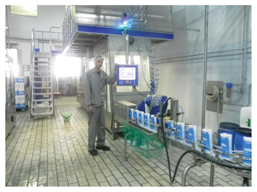 Namibia Dairies Team leader: Production, Karl-Heinz Kunze in front of the newly installed  filling machine.