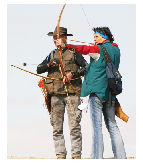 Rene Aebi (left) and Heidi Fink (right, at full draw) using longbows which evolved from Europe's Medieval Artillery.