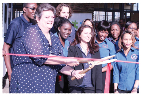 Namibia Medical Care Principal Officer, Allison Begley (holding the shears)and PharmAccess Managing Director, Ingrid de Beer (centre) were joined by the Mister Sister staff to celebrate the arrival of two mobile clinics.
