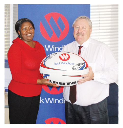 Nora Ndopu, Communication Practitioner: Stakeholder Engagement at Bank Windhoek and Riaan van Rooyen, Head: Corporate Communication and Social Investment at Bank Windhoek holding the rugby ball which will be signed by all the invited sports legends and auctioned for charity on 21 September.