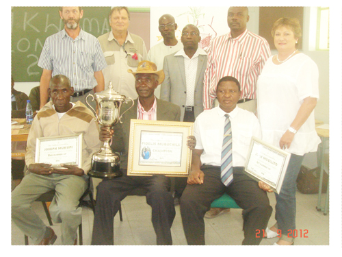 Front (left to right): Third prize winner Joseph Mukupi; Caprivi Dry Land Champion Maize Farmer, Fidelis Mubuchile and second prize winner, John Musilizo. Back (left to right): Hannes Grobbelaar, member of the Namibian Agronomic Board and evaluation team member; Christof Brock, CEO of the Namibian Agronomic Board ; Pastor Matthias Semi, member of the Namibian Agronomic Board and evaluation team member ;Cllr Cletius Sipapeke, Regional Governor: Linyanti Constituency; Matthew Mushabati: CAEO, Ministry of Agriculture, Water and Forestry, Directorate Extension and Engineering Services and Antoinette Venter, Administrative Manager of the Namibian Agronomic Board and part of the evaluation team.