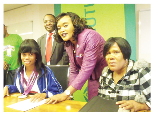 Old Mutual this week awarded paralympic Gold and Silver medallist Johanna Benson with a Unit Trust Investment of N$10,000. The funds are available on call for Johanna to access at any time whilst benefiting from the competitive rates. Old Mutual will also make available a financial advisor to assist the country's golden girl with her financial planning. (In the picture) Old Mutual's CEO of Operations, Sakaria Nghikembua looks on while financial advisor, Hilya Matheus helps Johanna to open her Unit Trust Account. (Photograph by Lorato Khobetsi)