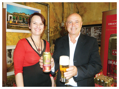 Gretha du Plessis, Media Manager at Castle Brewing Namibia and Cobus Bruwer, Managing Director at the launch of Castle Draught in a Can at the Playhouse Bistro on Wednesday. (Photograph by Lorato Khobetsi)