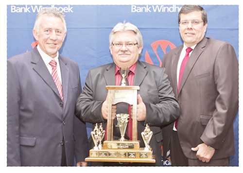 Branch Manager of Bank Windhoek Walvis Bay Branch Jans Stander (centre), poses with the Overall Best Branch Trophy, with Managing Director, Christo de Vries and Executive Officer: Banking Services, Chris Matthee.