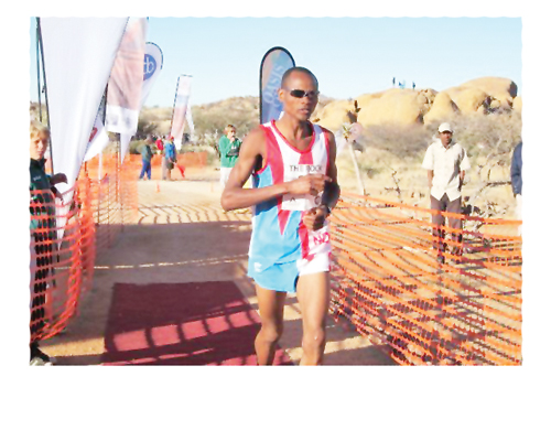 Winner of the 21.1km Pinehas Embashu looking relaxed as he approaches the finish line.