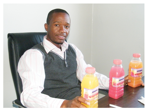 Male artist of the year 2012 and businessman, Albert Uulenga displaying his newly introduced Kassie Juice. (Photograph byYvonne Amukwaya)