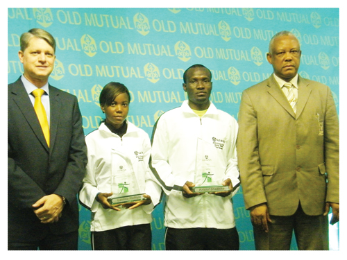 Left to right: Gim Victor, CEO: Retail Busines- Old Mutual,  Lavinia Haitope: 1st place Senior Female category, Kristof Shaanka, 1st place Senior Male category and Vetumbuavi Veii the Director of the Ministry of Youth, National Service, Sports and Culture. The two athletes, Lavinia Haitope and Kristof Shaanika will have the opportunity to compete at the Two Oceans Marathon in South Africa at the end of this month. (Photograph by Yvonne Amukwaya)