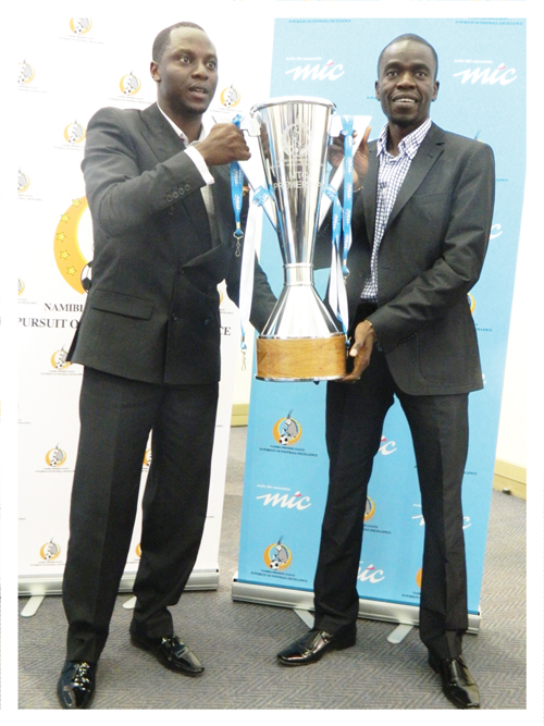 Tim Ekandjo, Chief Human Capital and Corporate Affairs Officer at  MTC and Johnny Doëseb, the Chairman of the Namibia Premier League holding the new cup at the launch of the 2012/13 MTC/NPL Premier League season . (Photograph Yvonne Amukwaya)
