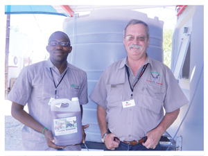 Abisai Nangolo and Peter Henderson with a sample of the organic solutions (Photograph by Hilma Hashange)