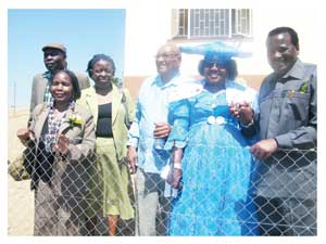 Enjoying the fruits of their blood and sweat. The beneficiaries of the houses Elias Alfeus, Elikana Shombe, Kay Ngeama standing in for her husband Alfons Ngeama, Gerson Veii, Adele Veii and Minister of Veteran Affairs, Nickey Iyambo. in front of Gerson Veii's newly-built house. (Photograph by Melba Chipepo).