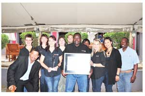 O&L Human Capital Director, Berthold Mukuahima with fellow employees proudly celebrating the achievement of overall winner in the SADC Region in the 2012 Deloitte Best Company To Work For survey.