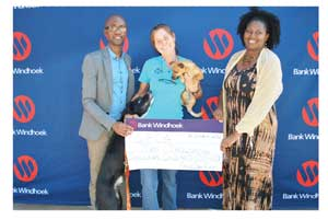 Hilary du Plessis (centre), manager of the SPCA, receiving the donation from Nora Ndopu and Toivo Mvula of Bank Windhoek.