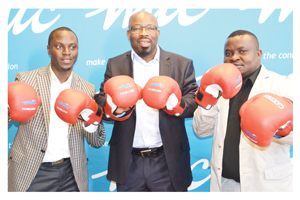 From left to right, Tim Ekandjo, MTC Chief Human Capital and Corporate Affairs Officer, Nestor Tobias and Malakia Elindi, from the Nestor Tobias Sunshine and Fitness Academy.