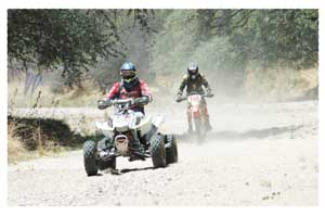 Eugene Rossouw on his quadbike ahead of bike rider Max Simon, during the eighth and final round of the Bank Windhoek Namibian National Enduro series race held at Gross Barmen near Okahandja last weekend. (Photograph Contributed)