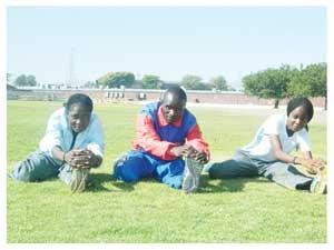 Athletes in training: Ndeshimona Ekandjo, Jonathan Mwandingi and Lavinia Haitope at the Katutura Youth Complex Stadium. (Photograph Yvonne Amukwaya)