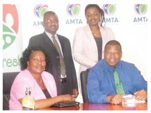 New Agribus Dev board members are (from left to right) Anna Shiweda, Abraham Nehemia and Albertina-Taina Nankela with Minister John Mutorwa (Photograph by Hilma Hashange)