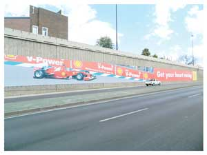 One of the biggest wall signs depicting the Formula One Grand Prix by Rama Media  is seen on a bridge in Mandume Ndemufayo Avenue (Photograph by Hilma Hashange).