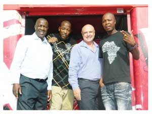 "From the left: Lemmy Shapopi, Corporate Affairs Manager, Castle Brewing, hiphop artist Jericho, Cobus Bruwer, Managing Director, Castle Brewing, and The Dogg pose on the mobile stage of the Castle Lager ""Gig Rig"" that will be used for the ""Summer Sizzle"" Northern Roadshow. (Photograph by Lorato Khobetsi)"