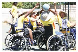 Basketball is an important therapeutic tool to help quadriplegics adapt to their wheeled mobility.