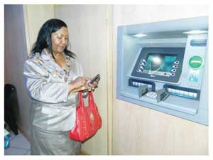 Mayor of the City of Windhoek, Elaine Trepper  is one of the first people to try the eWallet, a new service by FNB. (Photograph by Hilma Hasange)
