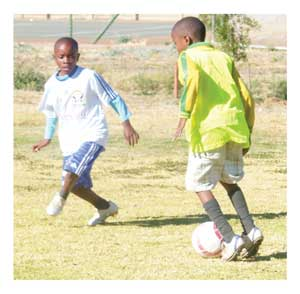 A young player tries to go past an opponent at a previous tournament.