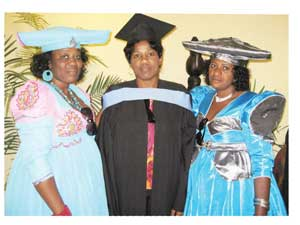 NWU BEdHons student Gustaphine Mbetjiha with sisters at the Windhoek graduation Nov 2012.