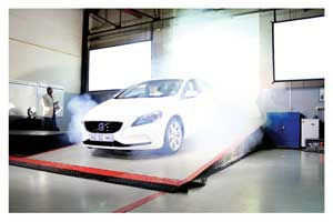 The new Volvo V40 emerges from a cloud of stage smoke at the Volvo Cars premises at the launch on Tuesday.