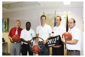 (Left to right) German Deputy Head of Mission to Namibia, André Scholz hands over basketball equipment to NBF acting president, Andrew Masongo at the German Embassy. Looking on is Peter Schey (German coach), Frank Albin (basketball expert) and Christian Mahnke (Cultural Desk Officer).