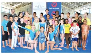 Vasile Bagdan (back row left), Head Coach (Male Artistic) at Excelsior Gymnastic Club; James van der Westhuizen (centre left), Chairperson of Excelsior Gymnastics Club; Nora Ndopu (centre right) of Bank Windhoek and Juliana Simonfi (far right), Head Coach (Female Artistic) at Excelsior Gymnastics Club with some of the young male and female gymnasts who will take part in the National Artistic Gymnastics Championships this weekend. (Photograph contributed)