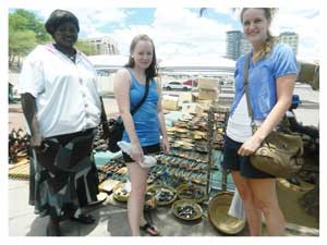 First time visitors to Namibia, Camilla Sorensen and Runa Nordhaug are from Norway. They have been in the country for the past two months. The two women were captured earlier this week buying local souvenirs from meme Penny in Windhoek.(Photograph by Hilma Hashange).