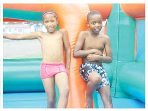 Children from the Orlindi Place of Safety, having a good time on a jumping castle.(Photographed by Melba Chipepo)