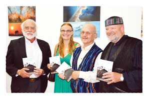 Bryony van der Merwe, second from left, with Director of the Uranium Institute, Dr Wotan Swiegers (left), author Dr Joh Henschel and Hon. Anton von Wietersheim (MP).