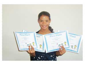 A cheerful Keara Kaylan Beukes displaying her achievements.
