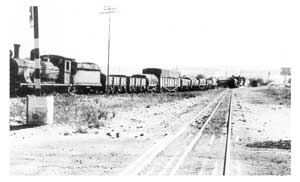 Two trains departing Usakos in the period before 1960. Usakos was the main shunting point for trains from Windhoek, the coast, and the north.