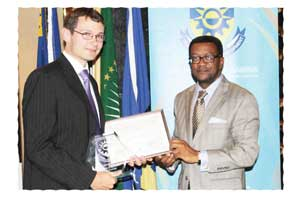 Kasper Jenson, Researcher of the Year and the Rector of the Polytechnic, Prof. Tjama Tjivikua. (Photograph Yvonne Amukwaya)