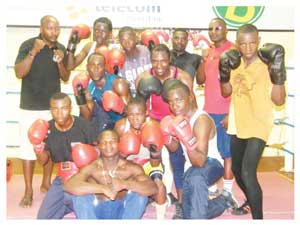 In the picture: Dedicated and enthusiastic boxers from the Tiger Cage Club with promoters and trainers in the ring during a training session. (Photograph Yvonne Amukwaya)