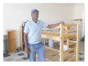 Phineas Nuuyoma in his factory in Lüderitz where he makes wooden beds and cabinets.