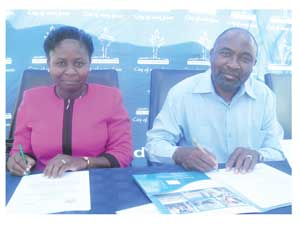 Selma Ambunda, executive of training and development at NTS and Nillo Tapopi, CEO of the City of Windhoek signing a 5-year Memorandum of Understanding in Otjimuise this week. (Photograph by Lorato Khobetsi)