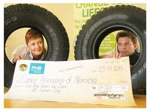 Chief Executive Officer of the Cancer Association of Namibia, Reinettte Koegenlenberg and Werner Wiese of Quality Tyres at the handover.(Photograph by Melba Chipepo).