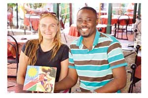 Bryony van der Merwe from Wordweaver Publishing with Romeo Sinkala, author and illustrator of Sumbu.