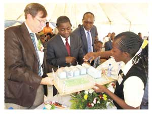 A learner explains her model of an upgraded school to Patrick Fine, Abraham Iyambo and Tom Alweendo. Fine is the Vice President of the Millennium Challenge Corporation in the USA, Iyambo is the Minister of Education and Alweendo is the director of the National Planning Commission as well as the Chairman of the Board of MCA Namibia.