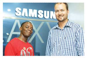 "One of the Namibian winners, Mr Machellus Xoagub with the Samsung brand store manager, Theo Senekal. This will be the first time in his life that Machellus will visit South Africa. He said: ""I am very happy and excited about the big win. For years I have been waiting to win something and now the big one has landed in my yard. Thank you Samsung, you guys are awesome."""
