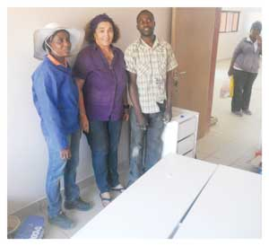 Diina Shivolo (left) used a small loan from Junior Achievement to start a coffin and cabinet factory in Keetmanshoop.