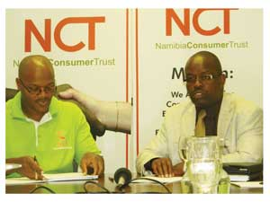 Executive Director of Namibia Consumer Trust, Michael Gaweseb and Chairperson of Namibia Consumer, Sandi Tjarondo during a media briefing (Photograph by Hilma Hashange).