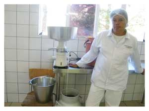 Barbara Visagie is in charge of the separator that skims the cream from the milk. The cream is then used to produce butter. (Photograph by Hilma Hashange)