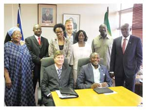 The Deputy Minister of Environment and Tourism, Pohamba Shifeta (seated right) with members of the Sustainable Development Advisory Council (Photograph by Bryn Canniffe).