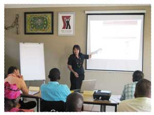 Claudine Mouton guiding entrepreneurs on the compilation of a business plan. (Photograph contributed)