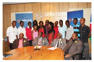 The Deputy Minister of Education, Dr David Namwandi (second from left) seated next to Telecom Namibia MD, Frans Ndoroma (second from right) during a media briefing to announce the hand over of bursaries to 14 students.