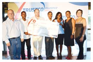 From the left; Adv. Raymond Heathcote (Chairman of the Trustco Group Holdings Board), Ndamonao Ilovu (bursary recipient), Quinton van Rooyen (Managing Director of the Trustco Group), Johannes D. K. Kariseb and Natasha Ndilula (bursary recipients), Adv. Natasha Bassingthwaighte and Annette Brand (Head of Trustco Insurance Namibia).